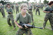 Female Marine Corps recruits go through close combat training at the United States Marine Corps recruit depot June 23 2004 in Parris Island South...