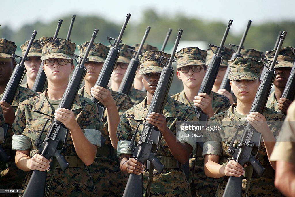 Female Marine Corps recruits pratice drill at the United States Marine Corps recruit depot June 22 2004 in Parris Island South Carolina Marine Corps...