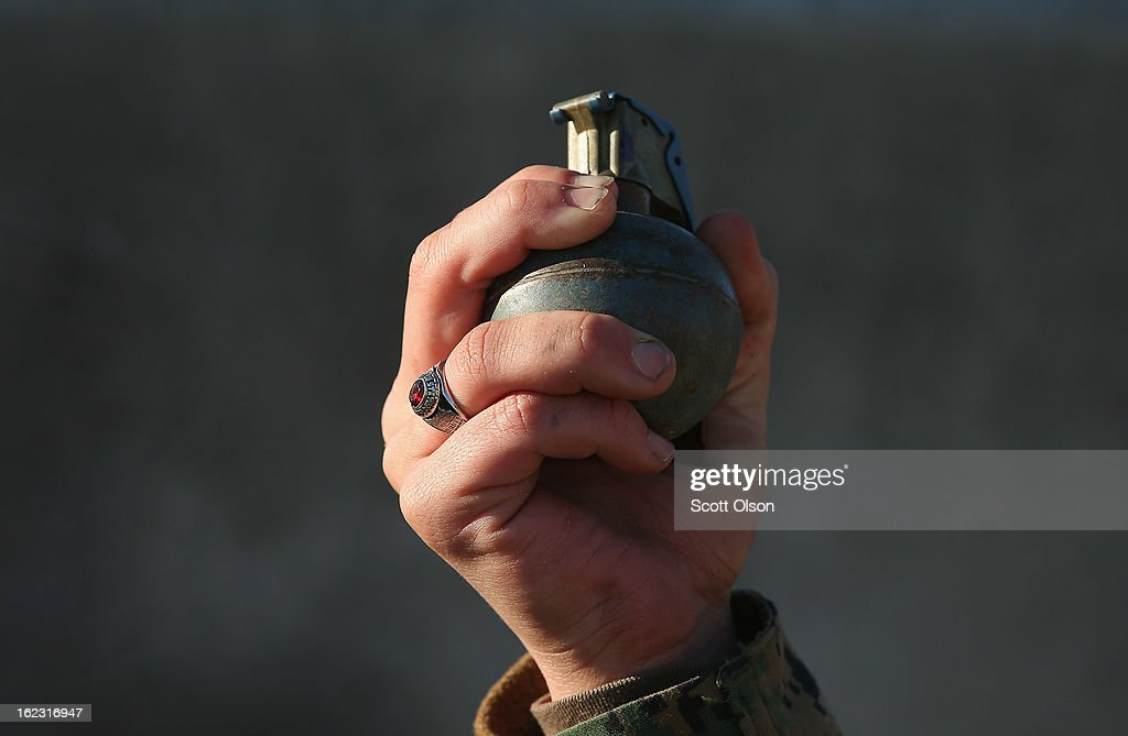 A female Marine prepares to throw a practice grenade during Marine Combat Training on February 21 2013 at Camp Lejeune North Carolina Since 1988 all...