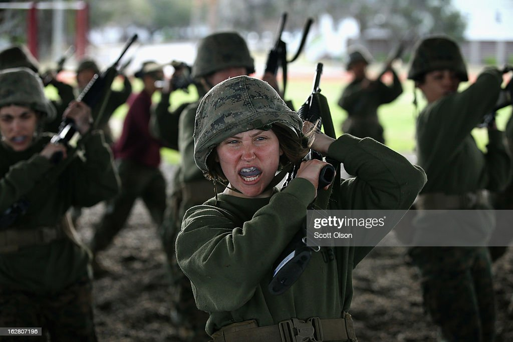 Female Marine recruit Natasha Rodenbaugh responds to a command during handtohand combat training in boot camp February 27 2013 at MCRD Parris Island...