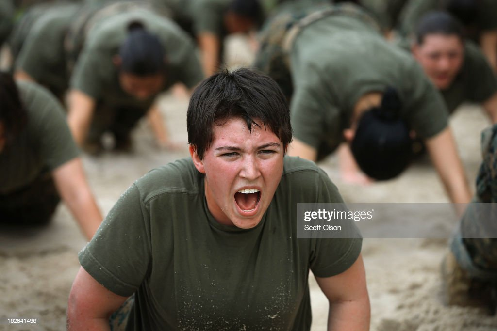 Female Marine recruits are disciplined with some unscheduled physical training in the sand pit outside their barracks during boot camp February 27, 2013 at MCRD Parris Island, South Carolina. Female enlisted Marines have gone through recruit training at the base since 1949. About 11 percent of female recruits who arrive at the boot camp fail to complete the training, which can be physically and mentally demanding. On January 24, 2013 Secretary of Defense Leon Panetta rescinded an order, which had been in place since 1994, that restricted women from being attached to ground combat units. About six percent of enlisted Marines are female.