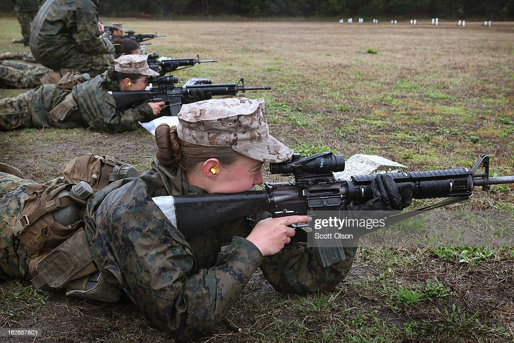 Female Marine recruits fire on the rifle range during boot camp February 25, 2013 at MCRD Parris Island, South Carolina. All female enlisted Marines and male Marines who were living east of the Mississippi River when they were recruited attend boot camp at Parris Island. About six percent of enlisted Marines are female.
