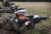 Female Marine recruits fire on the rifle range during boot camp February 25 2013 at MCRD Parris Island South Carolina All female enlisted Marines and...