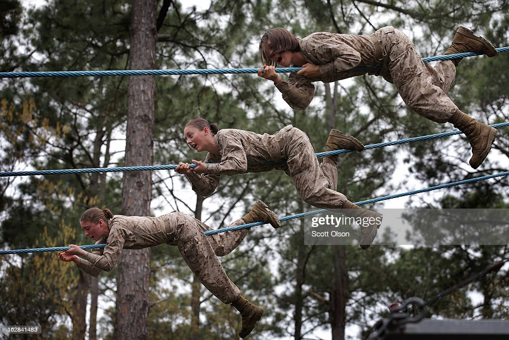 Female Marine recruits navigate an obstacle on the Confidence Course during boot camp February 27, 2013 at MCRD Parris Island, South Carolina. Female enlisted Marines have gone through recruit training at the base since 1949. About 11 percent of female recruits who arrive at the boot camp fail to complete the training, which can be physically and mentally demanding. On January 24, 2013 Secretary of Defense Leon Panetta rescinded an order, which had been in place since 1994, that restricted women from being attached to ground combat units. About six percent of enlisted Marines are female.