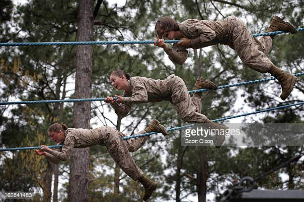 Female Marine recruits navigate an obstacle on the Confidence Course during boot camp February 27 2013 at MCRD Parris Island South Carolina Female...