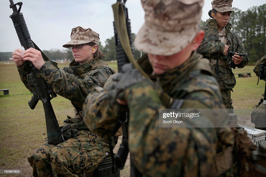 Female Marine recruits prepare to fire on the rifle range during boot camp February 25, 2013 at MCRD Parris Island, South Carolina. All female enlisted Marines and male Marines who were living east of the Mississippi River when they were recruited attend boot camp at Parris Island. About six percent of enlisted Marines are female.