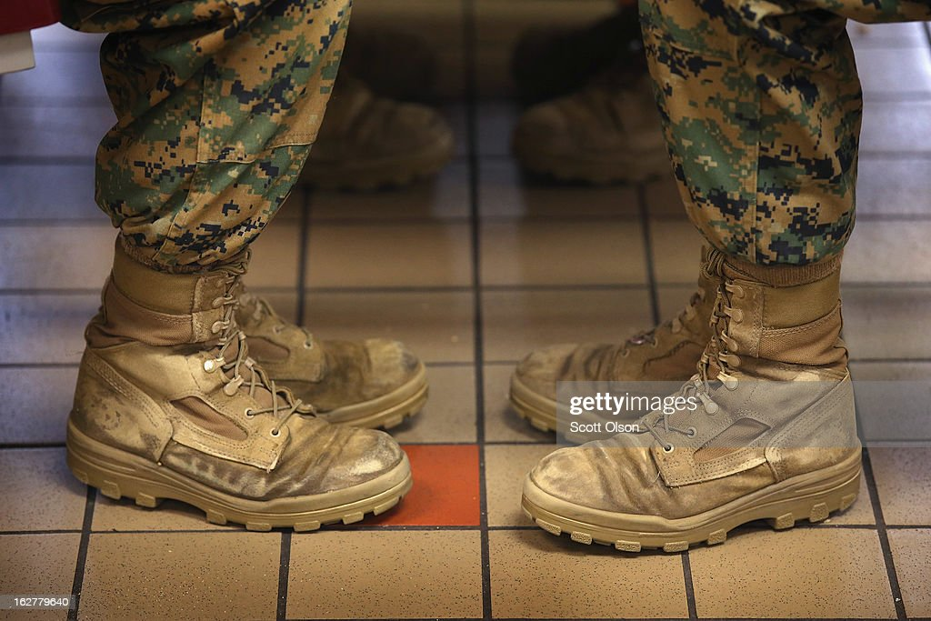 Female Marine recruits sit with their feet at a 45 degree angle, the same angle they are at while standing at the position of attention, while having lunch during boot camp on February 26, 2013 at MCRD Parris Island, South Carolina. Female enlisted Marines have gone through recruit training at the base since 1949. About 11 percent of female recruits who arrive at the boot camp fail to complete the training, which can be physically and mentally demanding. On January 24, 2013 Secretary of Defense Leon Panetta rescinded an order, which had been in place since 1994, that restricted women from being attached to ground combat units.