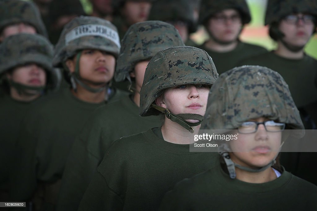 Female Marine recruits stand in formation during hand-to-hand combat training in boot camp February 27, 2013 at MCRD Parris Island, South Carolina. Female enlisted Marines have gone through recruit training at the base since 1949. About 11 percent of female recruits who arrive at the boot camp fail to complete the training, which can be physically and mentally demanding. On January 24, 2013 Secretary of Defense Leon Panetta rescinded an order, which had been in place since 1994, that restricted women from being attached to ground combat units. About six percent of enlisted Marines are female.