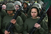 Female Marine recruits stand in formation following handtohand combat training during boot camp February 27 2013 at MCRD Parris Island South Carolina...