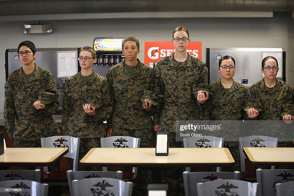 Female Marine recruits stand in line before getting lunch in the chow hall during boot camp on February 26, 2013 at MCRD Parris Island, South Carolina. Female enlisted Marines have gone through recruit training at the base since 1949. About 11 percent of female recruits who arrive at the boot camp fail to complete the training, which can be physically and mentally demanding. On January 24, 2013 Secretary of Defense Leon Panetta rescinded an order, which had been in place since 1994, that restricted women from being attached to ground combat units.