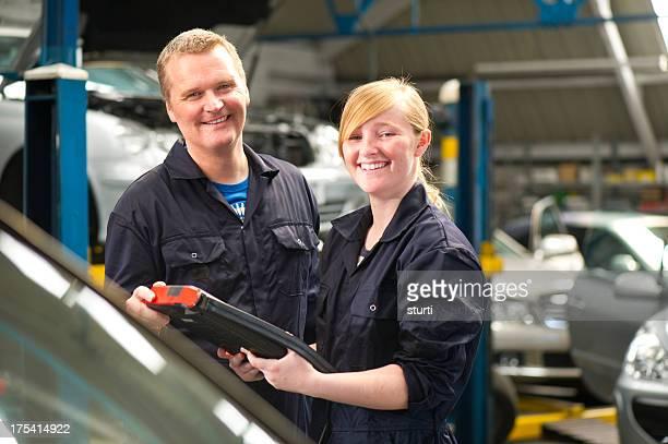 Female mechanic and boss
