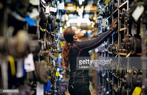 female mechanic organising storage