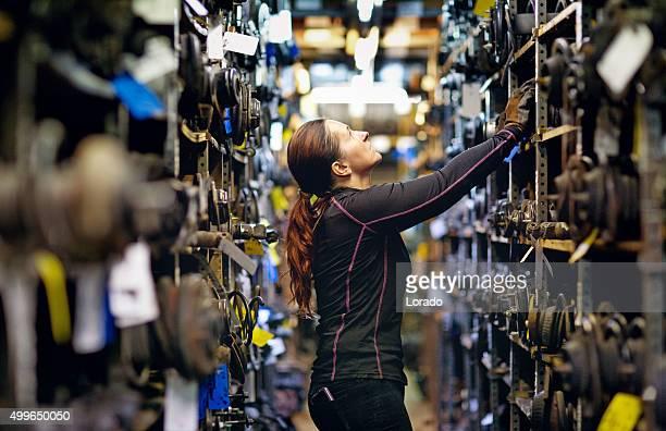female mechanic organising storage