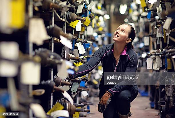 female mechanic working at storage
