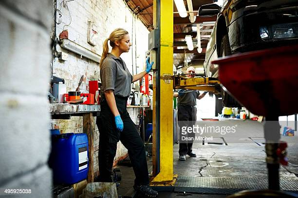 Female mechanic working in automobile garage