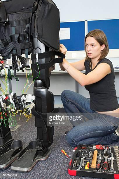 Female medical engineer working on a exoskeleton