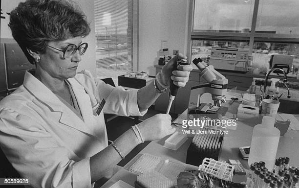 Female medical technician running immunoassays on blood samples from the chronic fatigue syndrome patients in the laboratory of Dr Paul Cheney