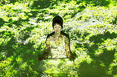 Female meditating in the moss
