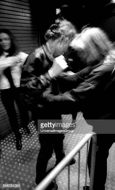 A female member of security searches a woman on the main door of the Hacienda Manchester early 1990's