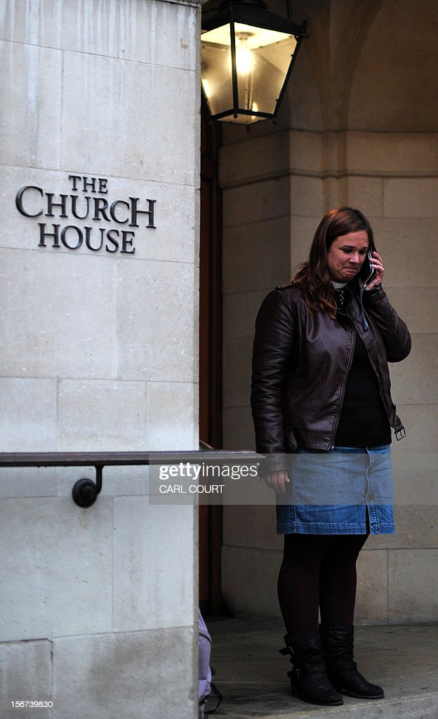 A female member of the clergy talks on her phone outside the venue of the three-day Church of England General Synod in central London on November 20, 2012, during which there will be a vote on whether to allow women to become bishops. The 470-member General Synod will vote on November 20 on the issue of women bishops which has split traditionalists and liberals, two decades after England's established state Church backed the introduction of women priests.