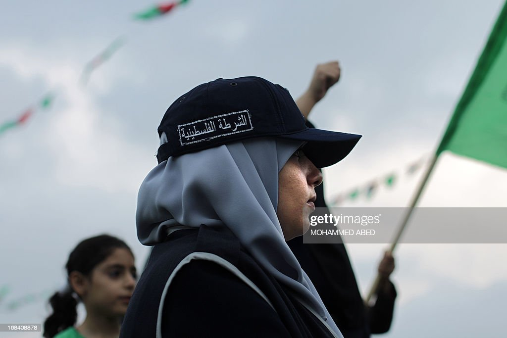 A female member of the Palestinian Islamic group Hamas security forces attends a festival of the International Association of Muslim Scholars head by Muslim cleric Yusuf al-Qaradawi on May 9, 2013 in Gaza City. Al-Qaradawi arrived on May 8, 2013 for his first visit to Gaza Strip with a delegation of Muslim scholars and warned that nobody was allowed to cede 'any part of Palestine'.
