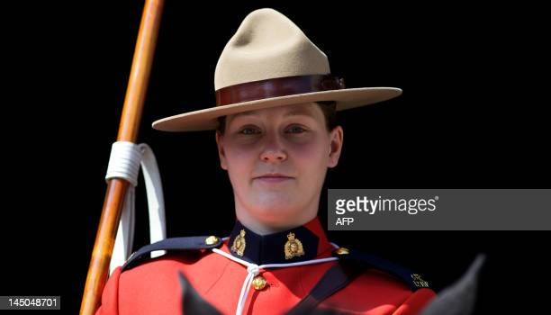 A female member of the Royal Canadian Mounted Police stands guard at Horse Guards Parade in central London on May 23 as the RCMP take part in the...