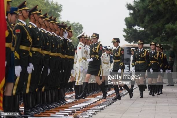 Female Members of a Chinese military honour guard prepare before a welcome ceremony for Sultan of Brunei Hassanal Bolkiah outside The Great Hall Of...