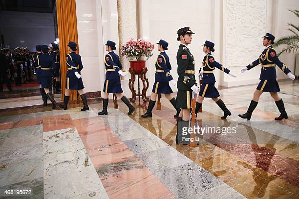 Female members of an honor guard march during a rehearsal before a welcome ceremony for Ugandan President Yoweri Kaguta Museveni at the Great Hall of...