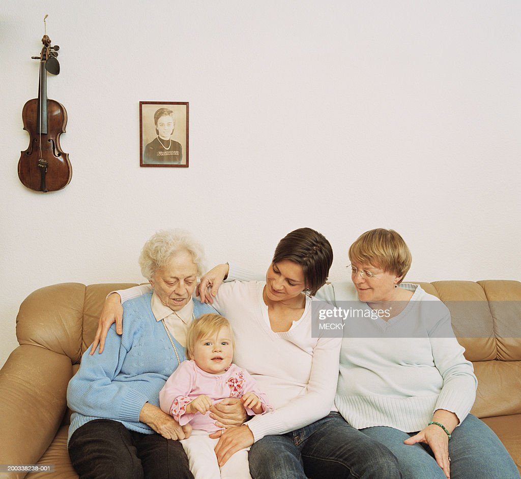 Female members of four generational family on sofa : Stock Photo