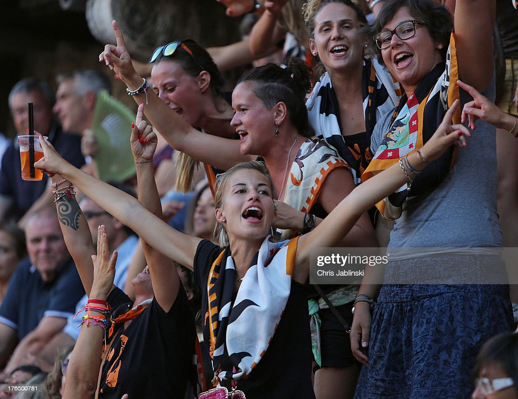 Female members of the Contrada della Lupa cheer before the first rehearsal for the Palio also called Prova on August 13, 2013 in Siena The so-called Tratta, in which the ten horses are allocated to the varying city districts or contrada is a precursor to the Palio di Siena, a twice annual summer event, in which riders representing city districts compete, in a tradition that dates back to 1656.