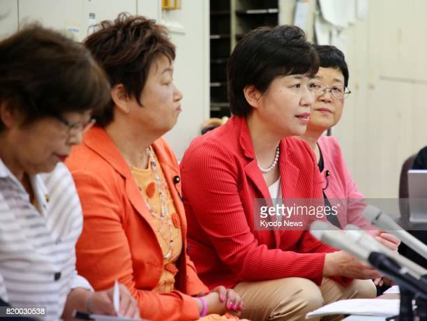 Female members of the Miyagi prefectural assembly attend a press conference at the prefectural government hall in Sendai on July 21 after submitting...