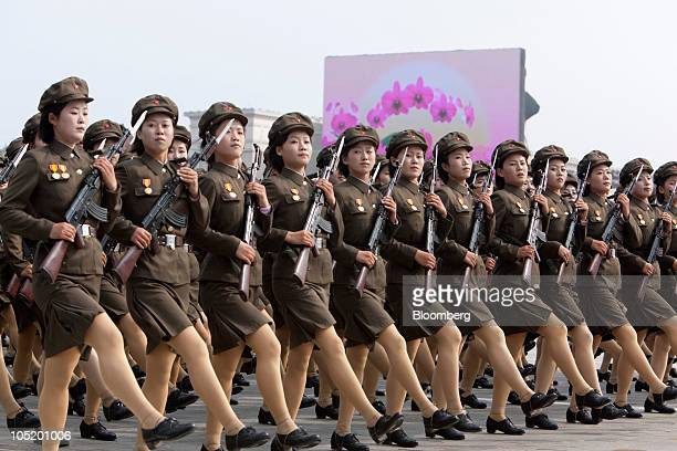 Female members of the North Korean military march during a parade commemorating the 65th anniversary of the Korea Worker's Party in Pyongyang North...