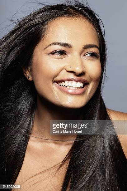 Female model smiling, looking into distance
