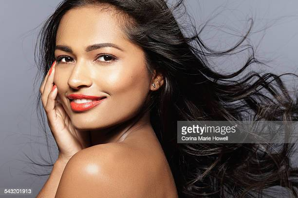 Female model smiling, looking over shoulder