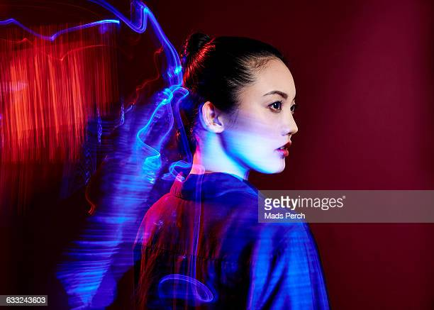 Female model surrounded by colorful lights