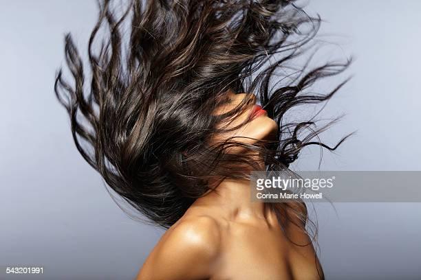 Female model throwing hair back