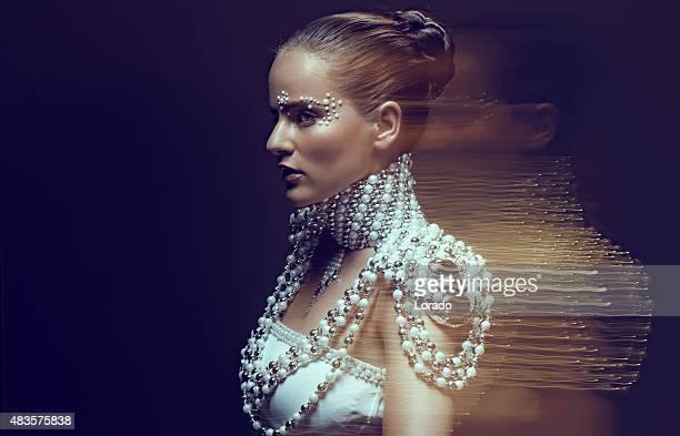 Female model wearing pearls jewellery