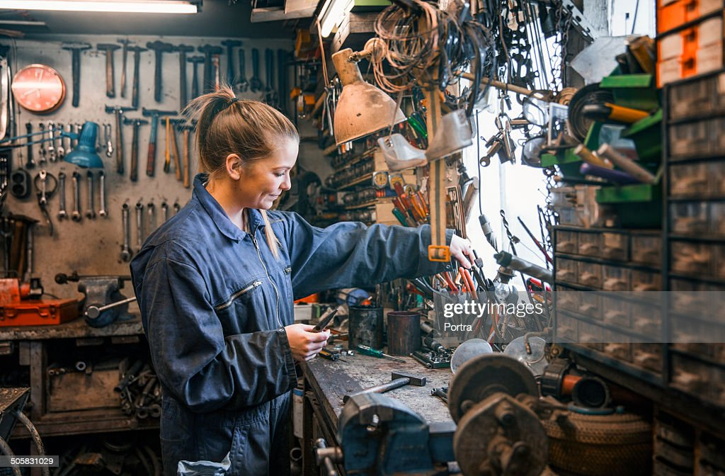 Female motor mechanic at work at the work shop.