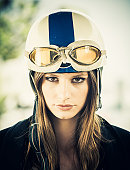 female motorcyclist with vintage helmet