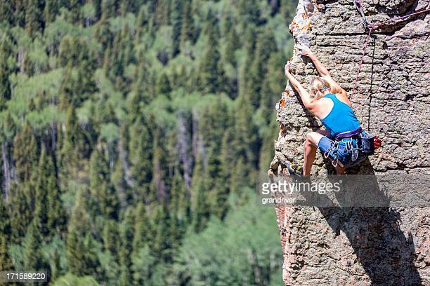 Female Mountain Climber on a Rock Face
