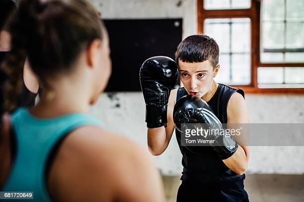 Female muay thai boxer during training session