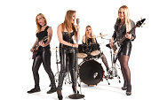 Portrait of female hard rock metal music band isolated over white background