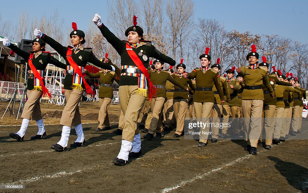 Female National Cadet Corps (NCC) members salute during India's Republic Day celebrations on January 26, 2013 in Srinagar, the summer capital of Indian Administered Kashmir. All businesses, schools and shops were closed and traffic remained off the roads following a strike call given by Kashmiri separatist leaders against India's Republic Day celebrations in Kashmir. Meanwhile India deployed large numbers of Indian police and paramilitary forces to prevent any incidents during the official celebrations.
