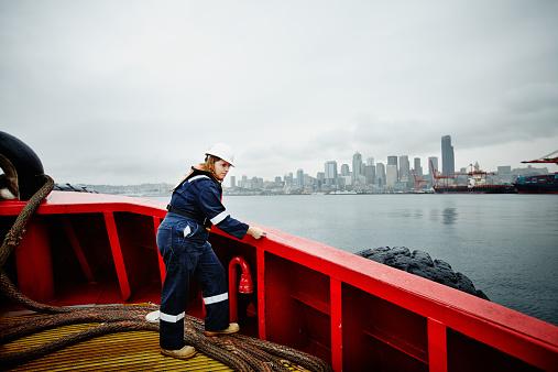 Female naval architect taking measurements