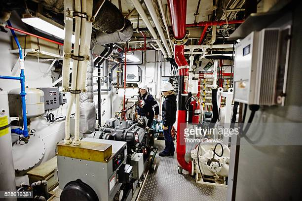 Female naval architects in tugboat engine room