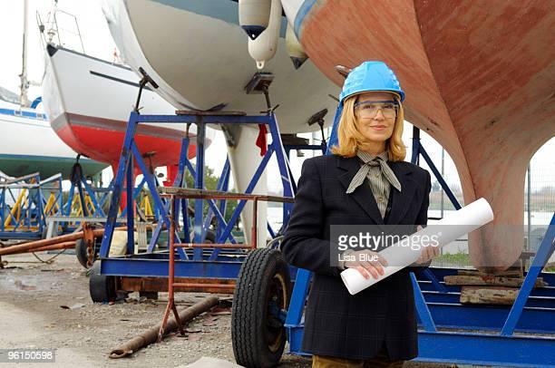 Female Naval Engineer with Plan