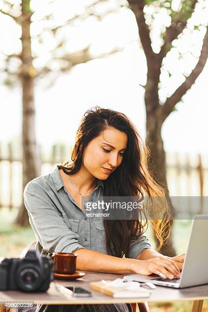 Female novelist writing on the laptop
