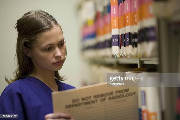 Female nurse holding a patient file