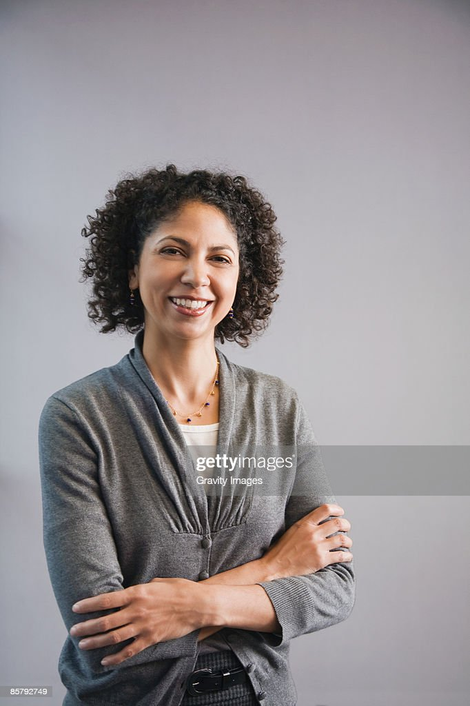 Female office worker smiling at camera, portrait : Stock Photo
