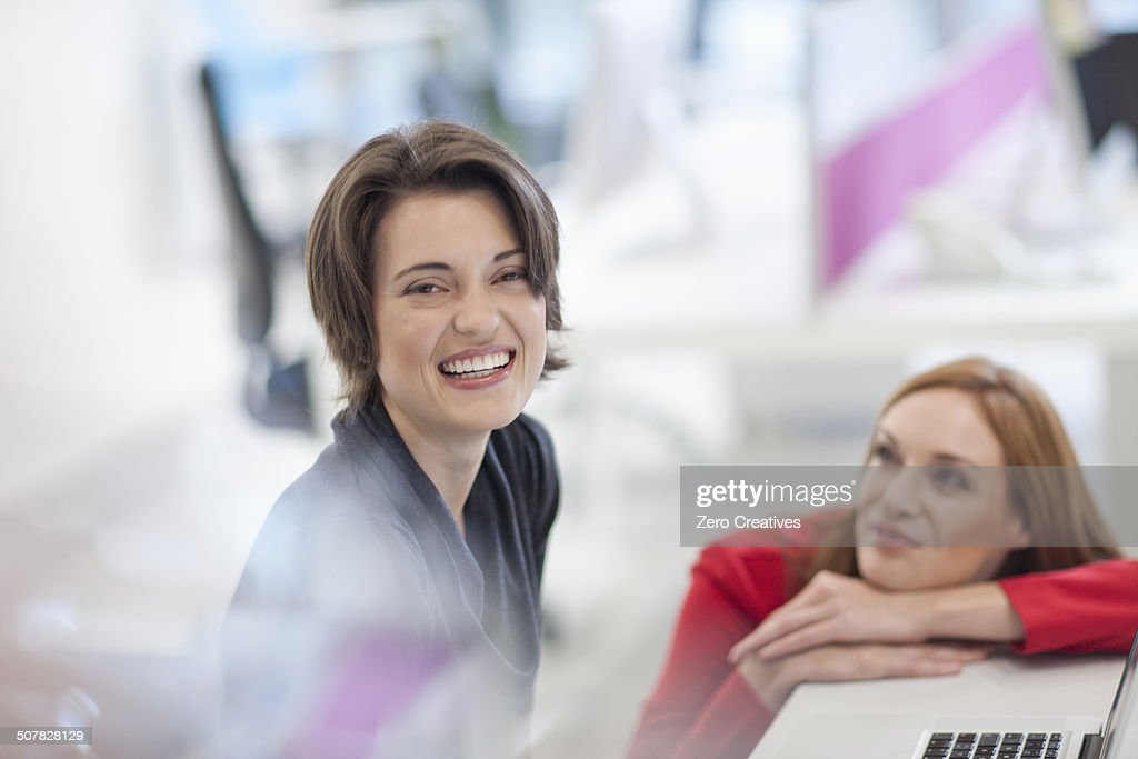 Female office worker smiling